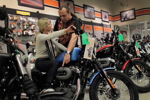 Harley Davidson salesman helping motorcycle customer